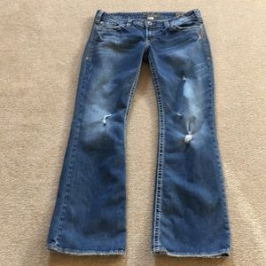 Silver pioneer boot cut jeans.